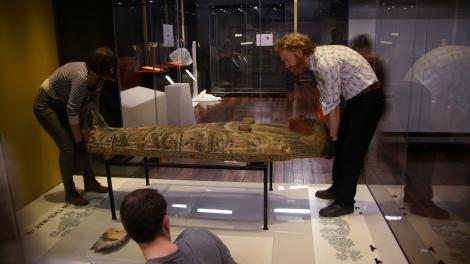 Preparing a sarcophagus for display in the exhibition