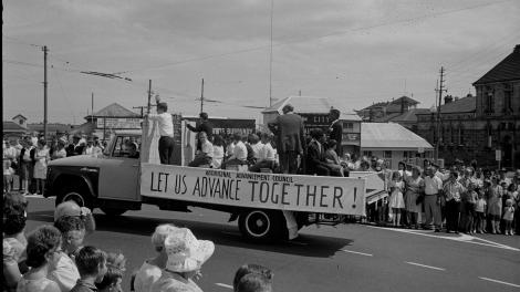 "Aboriginal Advancement Council banner 'Let Us Advance Together!"" displayed on a truck at the Labour Day procession, Perth 1966"