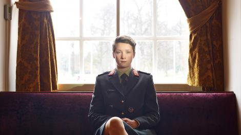 Photo of a cadet sitting in a room