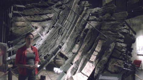 Wendy standing infront of the timbers of the Batavia wreck