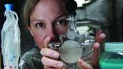 Amy Sharrocks holding a vial of collected water.