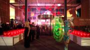 Entertainer twirling fluro light outside entrance foyer to Perth Museum