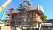 A square concrete box with fencing on the top.  This will be the lift that takes visitors up the Museum.