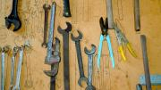 Image of tools hanging on the wall in a factory.