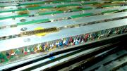 Image of freshly painted badges laid out on a drying rack.