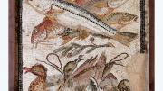 """A intricately tiled fresco depicting three large fish with gaping mouths, located above three ducks huddled together."""