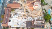 Aerial view of hte site.  The Beaufort Street heritage building is to the left, crane in the middle and construction of the lifts and galleries is under way.