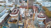 An aerial view shows the two lift cores on either side of the site