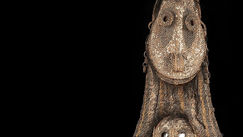 A double faced, tall woven dance mask from Kanganaman Village.