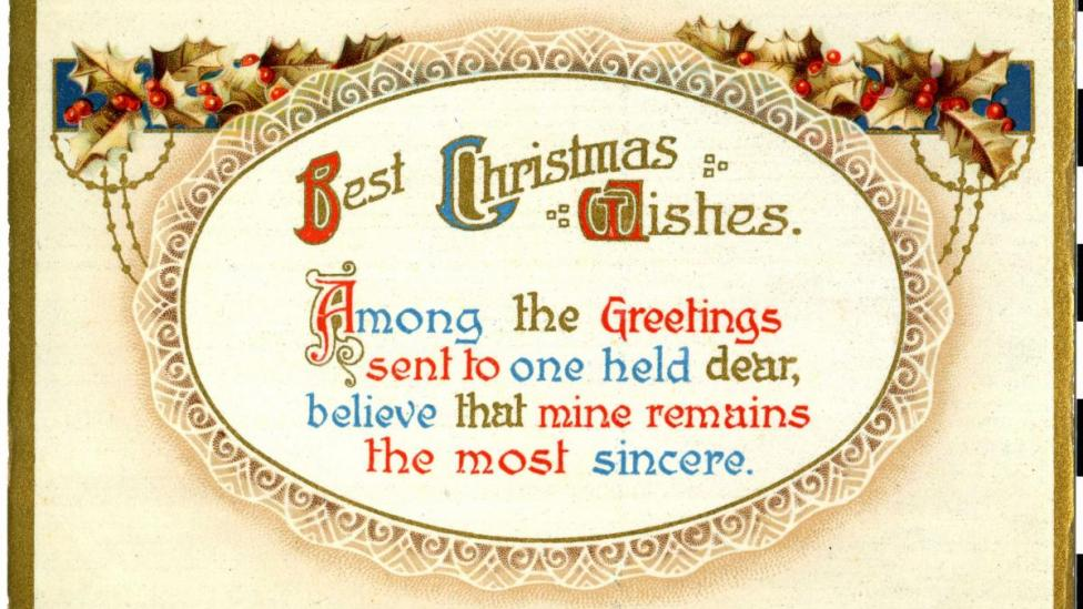 """Holly and gold border surrounds Christmas text."""