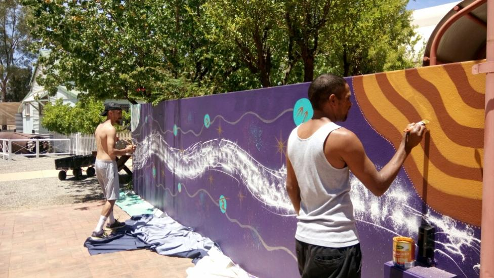 Dominique McKenzie and Desmond Cameron painting the mural