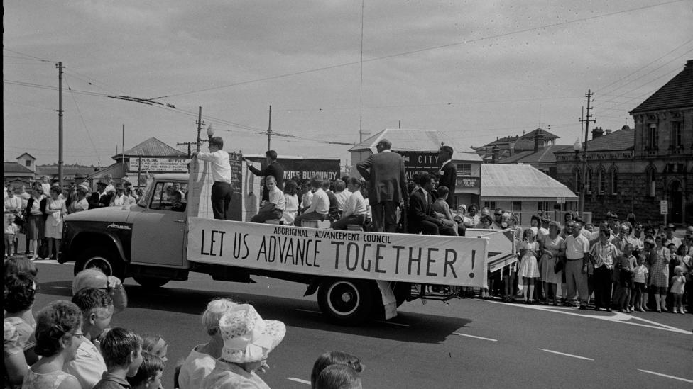"""Aboriginal Advancement Council banner 'Let Us Advance Together!"""" at the Labour Day procession, Perth 1966"""