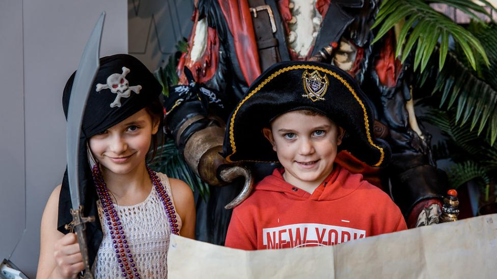 Two children dressed up as pirates.