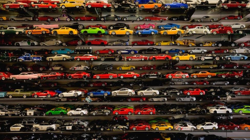 A large collection of toy cars on display shelves.