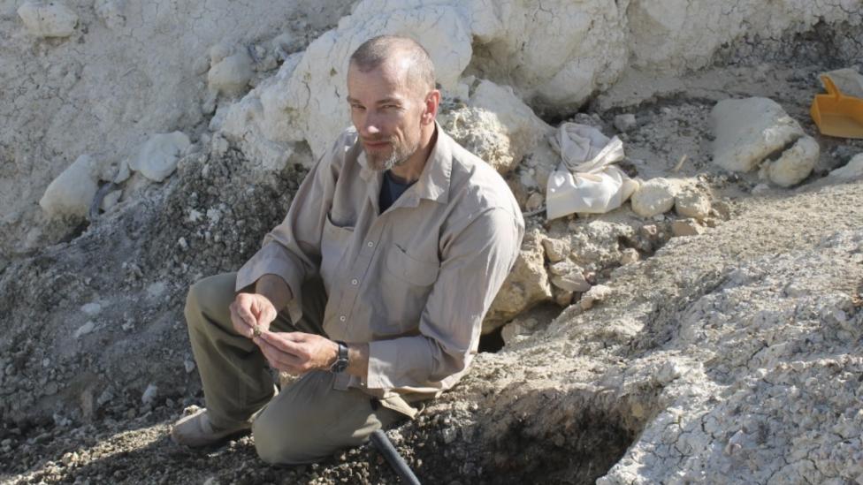 A man sitting on a rocks.