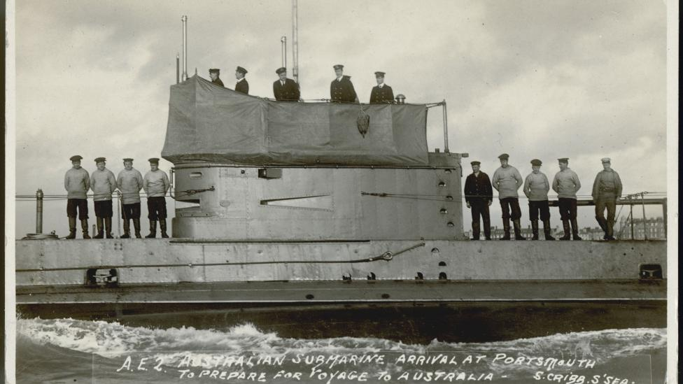 Australian submarine AE2 with crew on deck at Portsmouth, 1914. ANMM Collection gift from Mrs D Smyth.
