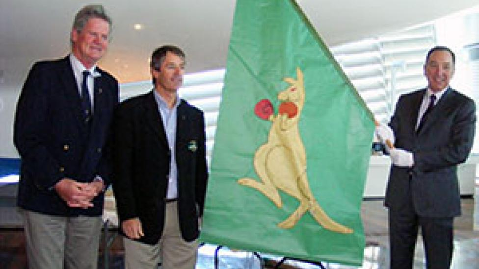 Left to Right: Former Australia II crewmen John Longley and Skip Lissiman present the Boxing Kangaroo flag to Tim Ungar, Chair of the Board of Trustees of the WA Museum.