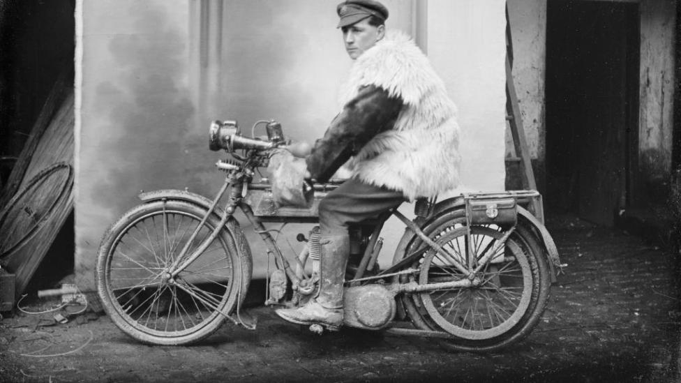 Corporal James Davie Renner, 4th Divisional Signals Company, of Fremantle, Western Australia. Corporal Renner is sitting on a motor cycle, appropriately dressed in a sheepskin vest during what was one of the coldest winters in decades on the Somme.