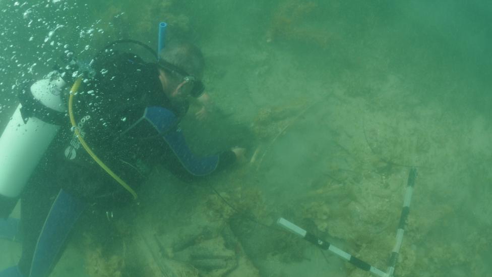 Western Australian Museum Maritime Archaeologist Michael 'Mack' McCarthy inspecting the wreck underwater at 7 Mile Beach