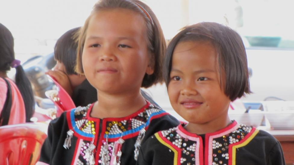 Two girls wearing traditional Thai Hill Tribe clothing