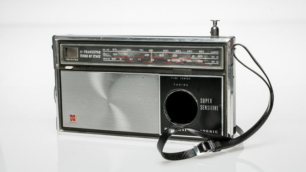 A silver and black radio adapted to conceal a camera, c1965.