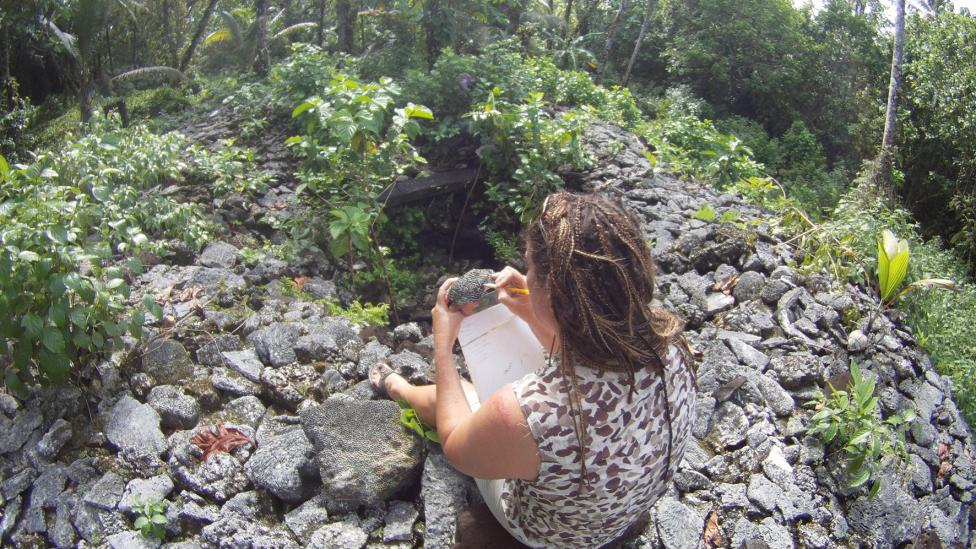 WA Museum's Dr Zoe Richards examining corals at one of the ancient Leluh tombs