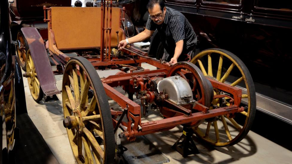 Western Australian Museum Technical Officer Salvador Gomez examining the car
