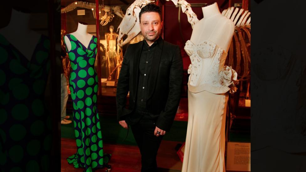 Aurelio Costarella standing next to two of his designs