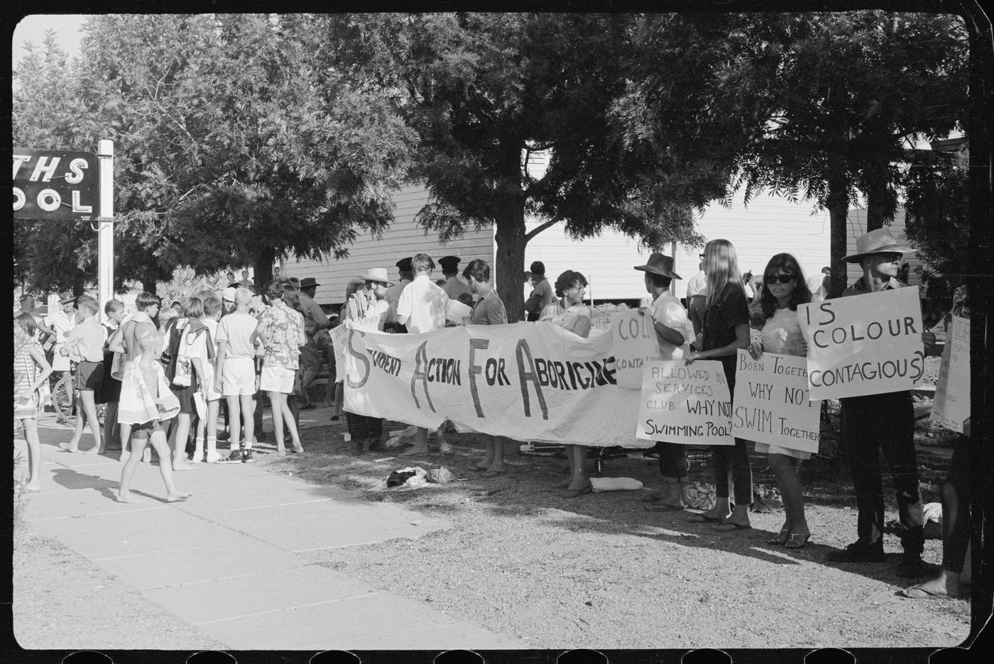 1965 Freedom Ride participants demonstrate against refusal to allow local Aboriginal children into the swimming pool in Moree. Their actions drew national and international attention to relationships between Aboriginal and non-Aboriginal people.