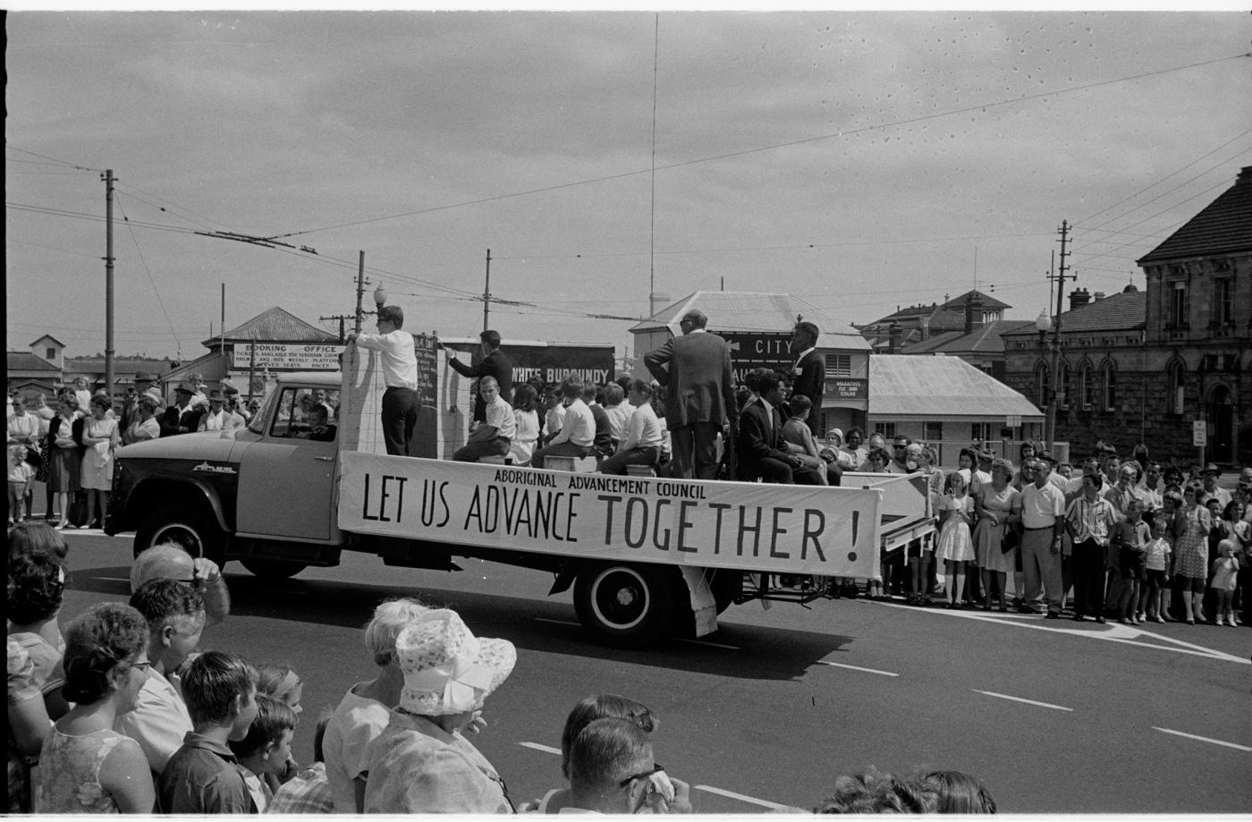 """Aboriginal Advancement Council banner 'Let Us Advance Together!"""""""