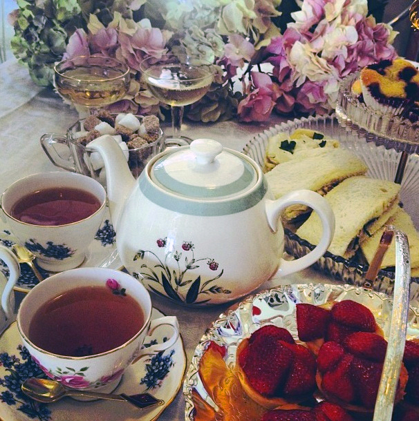 High tea at the Muse cafe showcasing tea, sandwiches and cakes